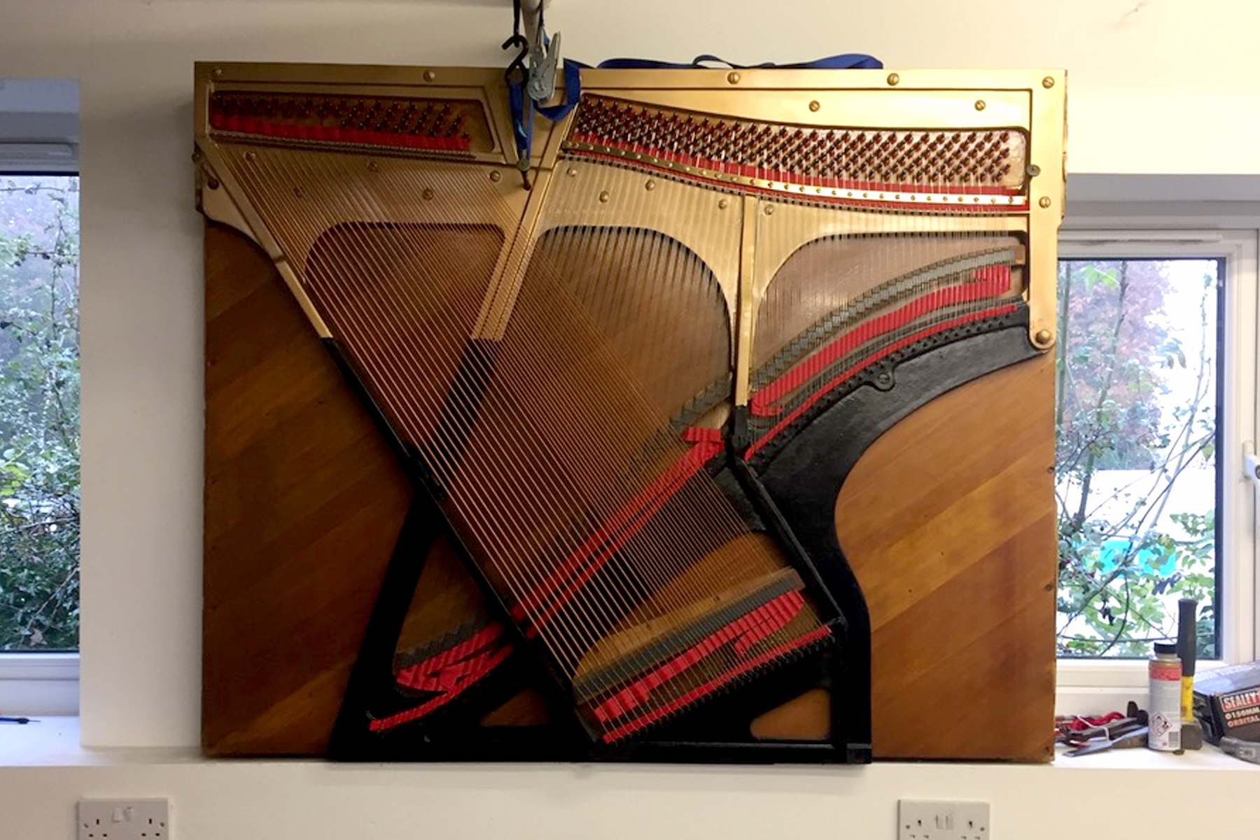 Hanging piano artwork